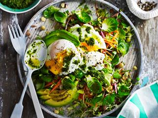 Breakfast salad with poached eggs and kale pesto