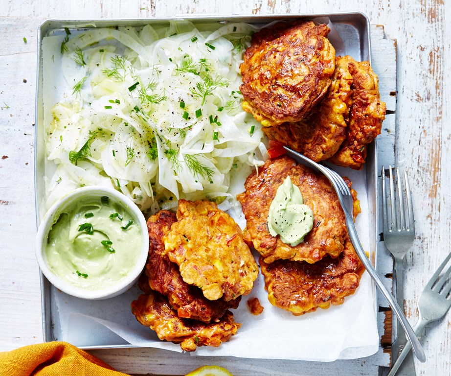 """**[Corn & bacon fritters with avocado dressing](https://www.womensweeklyfood.com.au/recipes/corn-fritters-11018