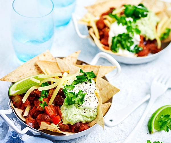 """**[Black bean chilli with guacamole and corn """"chips""""](https://www.womensweeklyfood.com.au/recipes/black-bean-chilli-with-guacamole-and-corn-chips-31537