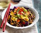 Brown fried rice with carrot, cabbage and red onion