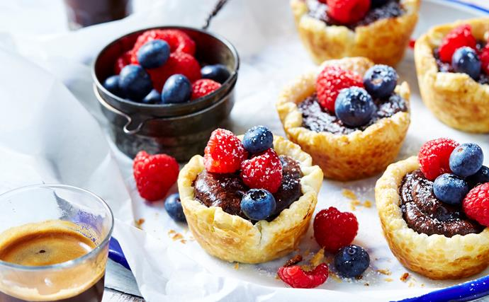 Chocolate custard tarts with fresh berries