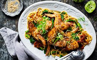 Soy-glazed chicken wings with noodles