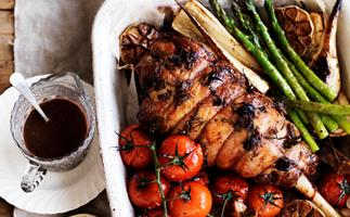 Roast lamb with anchovies, garlic and vegetables