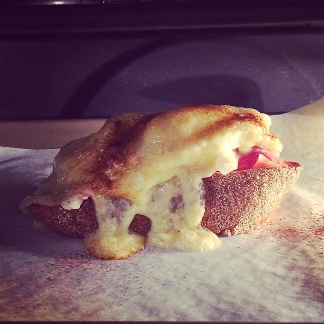"""Not just any cheese and ham toastie… """"Deliciousness melting in the oven #vintagechaddarcheese #tomato #ham #mustard #eggs #paprika #italianrusticbread"""""""