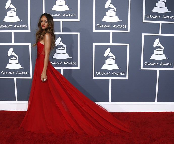 HIT: On the 55th Annual GRAMMY Awards red carpet, Rihanna made a statement with her dramatic Azzedine Alaia gown's train.