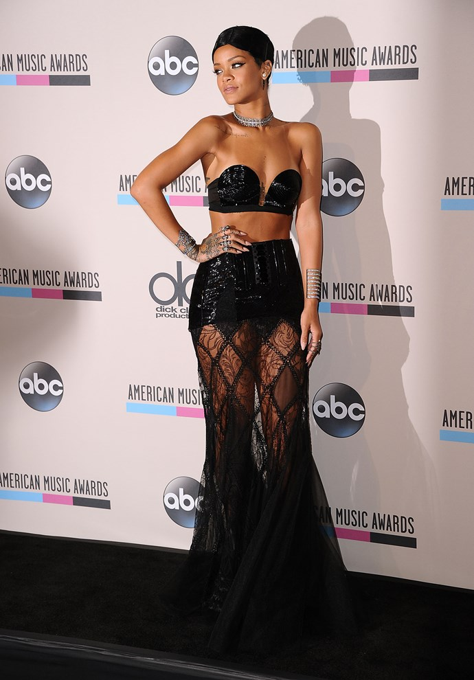 HIT: On the runway, this Jean Paul Gaultier gown came with a matching black lace crop top. In her quest to become an international style icon, Rihanna ditched the top for the 2013 American Music Awards and bared some serious skin.