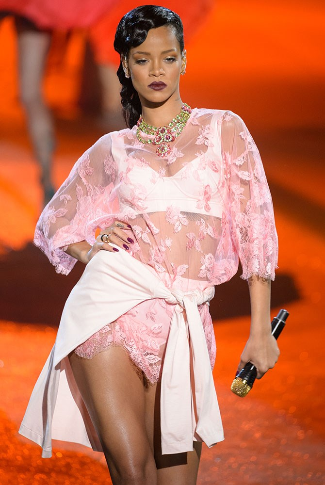 HIT: Singing *Diamonds* on the Victoria's Secret Fashion Show runway, Rihanna stripped down to her smalls (it seemed like the most appropriate place for it) but added her signature twist with a shirt tied around her waist.