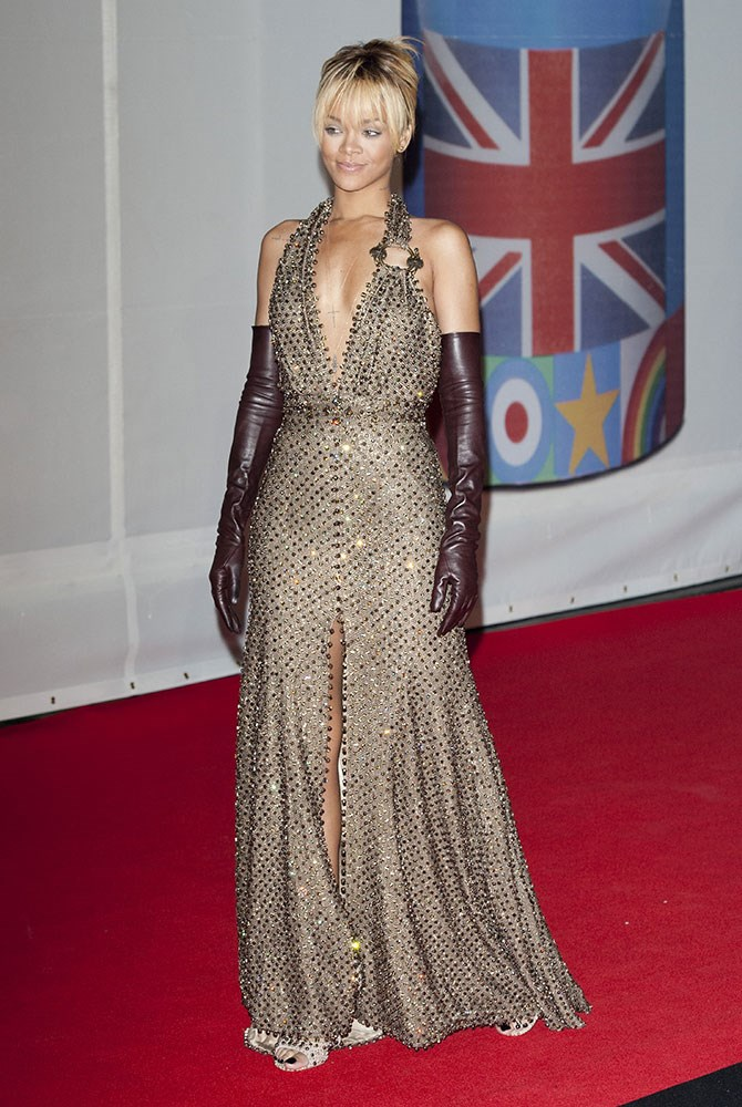 MISS: At the 2012 Brit Awards, RiRi's brown, embellished dress and matching leather gloves look more like they were pulled straight from a '90s red carpet than the Givenchy Haute Couture showroom.