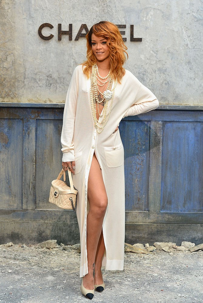 MISS: At Chanel's Paris Fashion Week Haute-Couture, the singer took her place front row in what could only be described as... a giant cardigan? Double C's or not, it's a major fail.