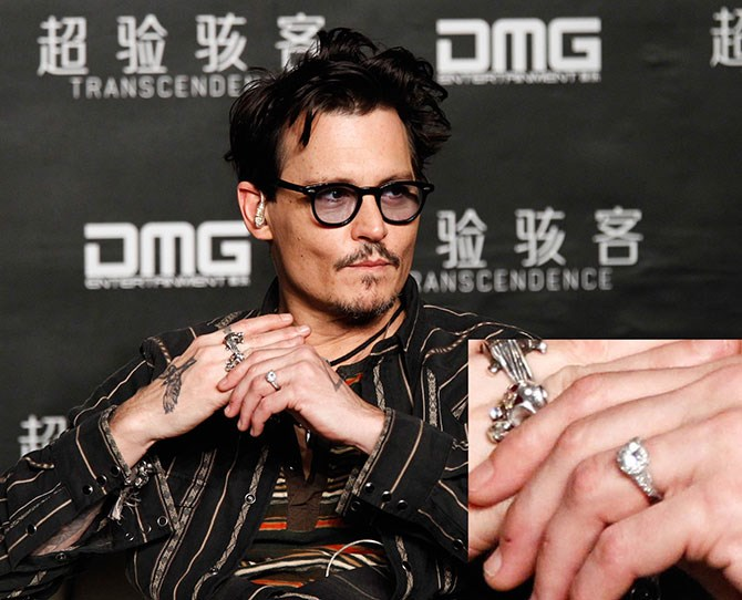 "Eye witnesses say Johnny, 50, was sporting a ring with a single diamond on a band around his ring finger. A source also told *Us Weekly* that the rock was in fact the one he proposed to 27-year-old Amber with, but it was ""too big for her, so he started wearing it."" But while he might be willing to rock girly engagement jewellery, Johnny revealed that he will have no part in planning the wedding, ""I think that I would be better at making women's shoes than I would be at wedding planning, I can't plan anything."" Buying the right sized ring included."