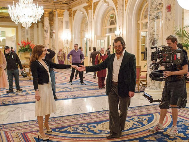 """*American Hustle*: In one scene con artist Irving Rosenfeld (Christian Bale) and his lovely partner-in-crime Sydney Prosser (Amy Adams) rejoice in the gilded hotel lobby of the [Fairmont Copley Plaza](http://fairmont.com/copley-plaza-boston/