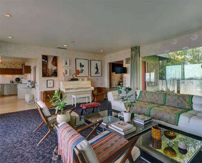 The bohemian style house boasts three bedrooms, two bathrooms, an outdoor shower, cedar hot tub, an 'entertaining deck' and a chicken coop – for organic living.