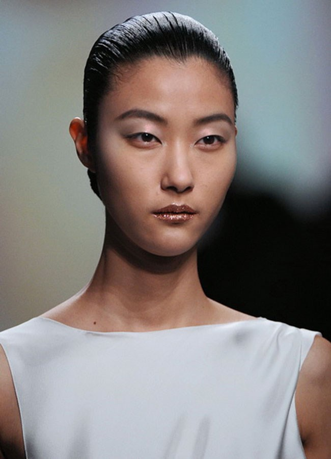"""Runway ready : For the full effect, after lipstick, """"Use a metallic eyeshadow or pigment from the centre of your lips and blend outwards,"""" says Mirarchi. Choose a soft shimmer rather than chunky glitter, which can look too 'costume party'."""