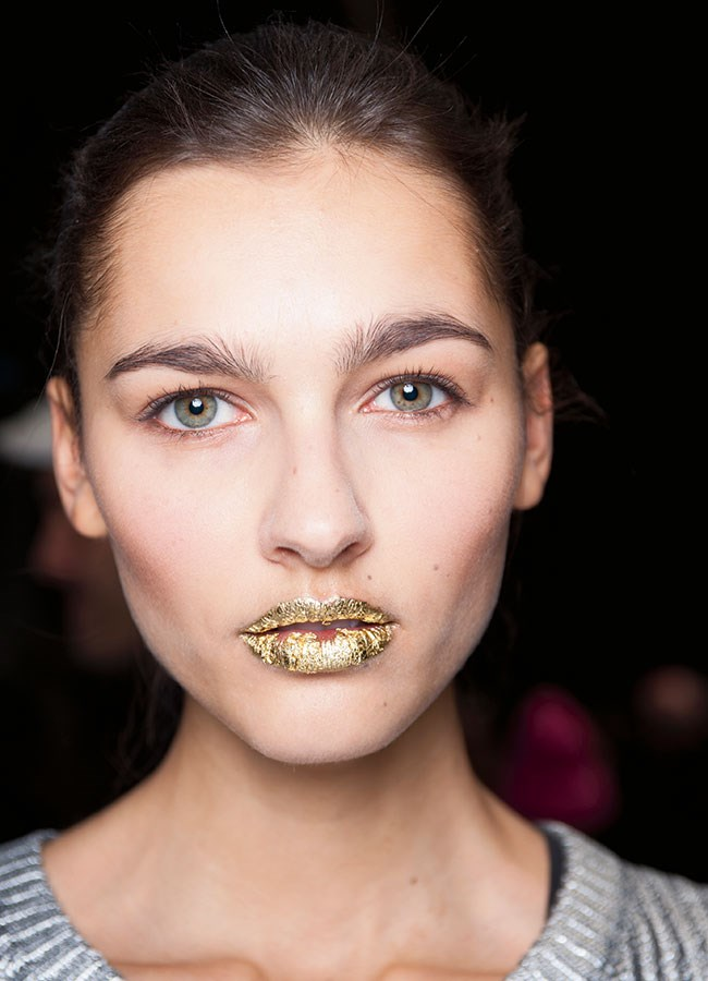 """Nod to fashion: For a subtle take, """"Try a shimmery gloss,"""" says Mirarchi. Or apply gloss just to the centre of the bottom lip. """"This reflects light, making lips appear bigger."""" If you're game for colour, get a """"stained"""" effect by pressing your lipstick on with a finger."""