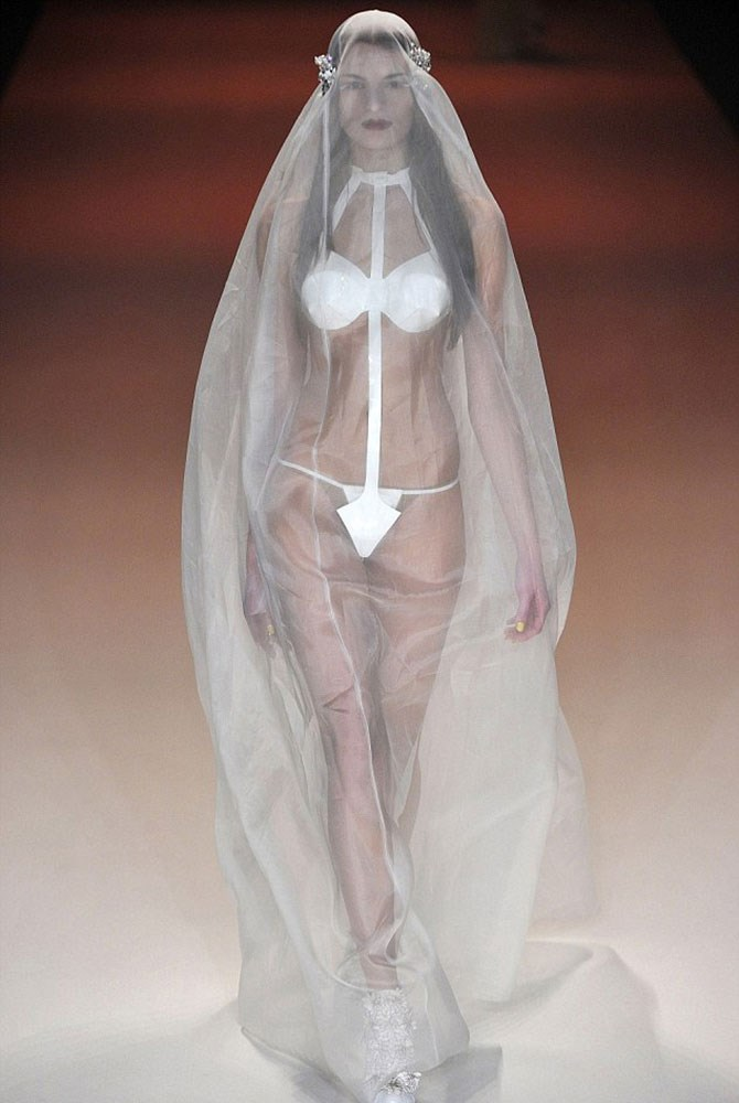 This kind of looks like she threw a veil over her paper knickers post-spray tan and headed to the chapel.