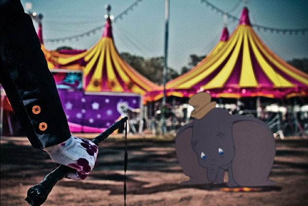 Dumbo faces the bloodied whip of a circus trainer. Quick, use your big ears to fly away!