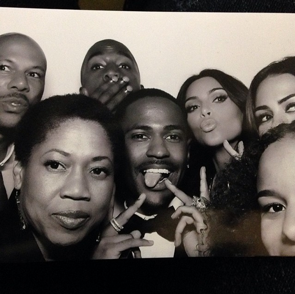 Posted by: Big Sean The newlyweds cram into the photobooth with Kanye's rapper pal, friends and family.
