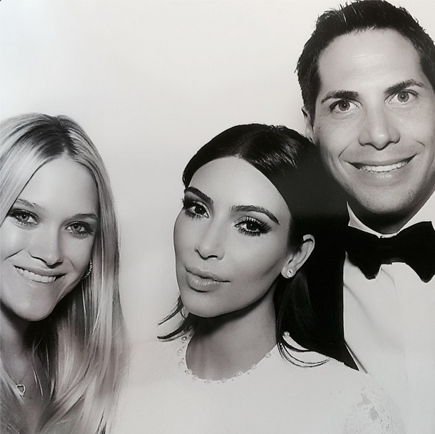 Posted by: Joe Francis This shot of Kim with family friend Joe and his wife shows a little more of the intricate detailing on her second dress of the night.