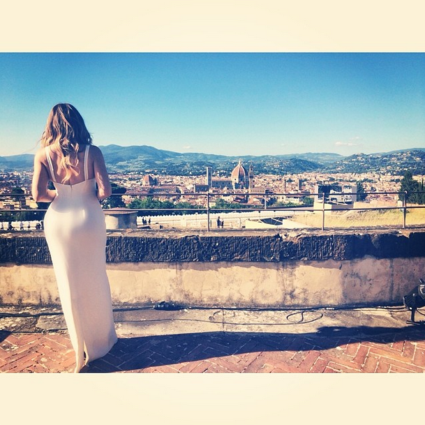 Posted by: Khloe Kardashian Now this one makes us jealous! Khloe enjoys the view over Florence, in her stunning yet simple bridesmaid dress (all the sisters were bridesmaids and wore mismatched white dresses).
