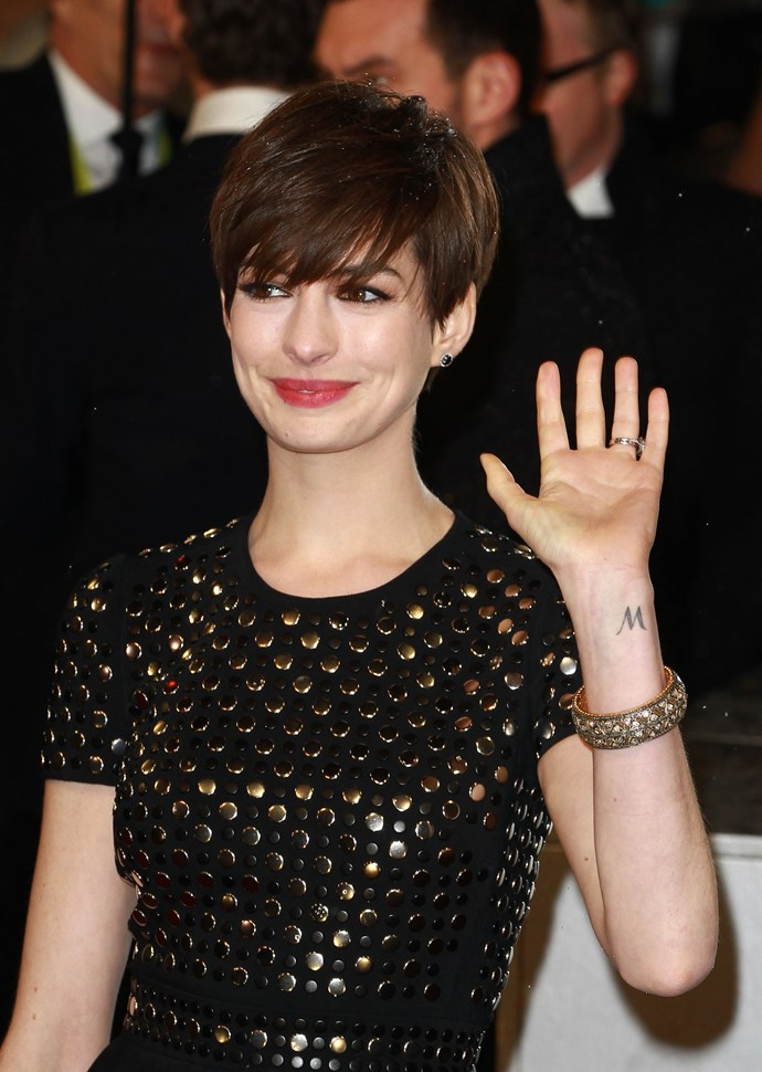 She's never publicly spoken about her tattoo, but sources guess that Anne Hathaway's 'M' tattoo could be a reference to her brother Michael, or her mother's maiden name McCauley.