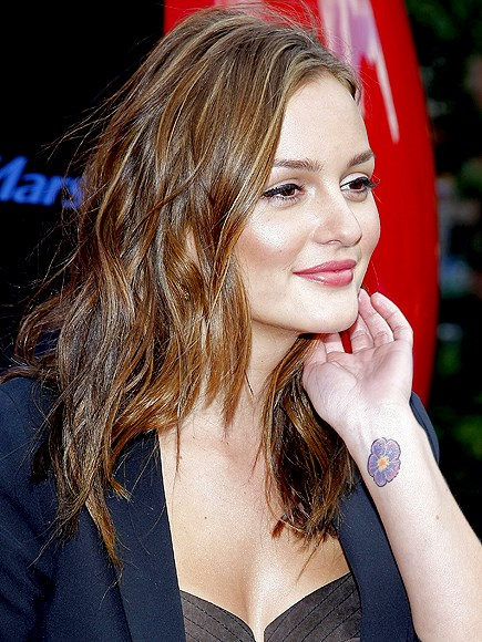 Leighton Meester has a colourful flower adorning her wrist.