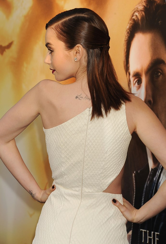 """Up-and-coming actress Lily Collins has """"Love, always and forever"""" inked across her back."""