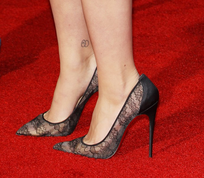 Scarlett Johansson has stated that she prefers to keep the meaning behind her tattoos private, but we're intrigued by the interlinking circles and letter 'A' etched on her ankle.