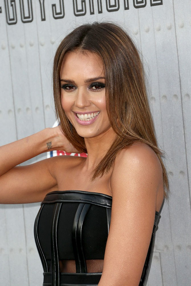 She had her flower and ladybug tattoos removed recently, but Jessica Alba still has the Sanskrit word for 'lotus' on her wrist (and a bow on her lower back).