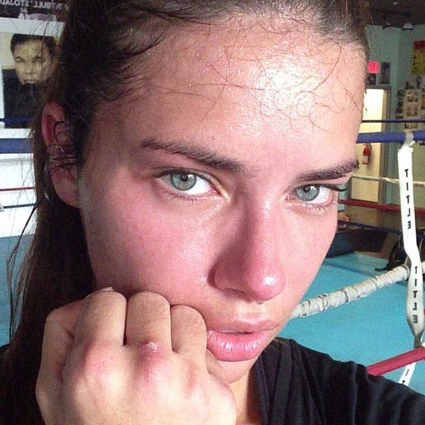 Adriana Lima might be an Angel, but sweating and going red at the gym she proves she's human just like the rest of us. Then again, even a blotchy, sweaty Adriana Lima is baben.