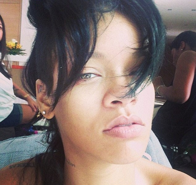 Putting the whole hair situation aside, pre-primping Rihanna shows off her natural beauty in this selfie.