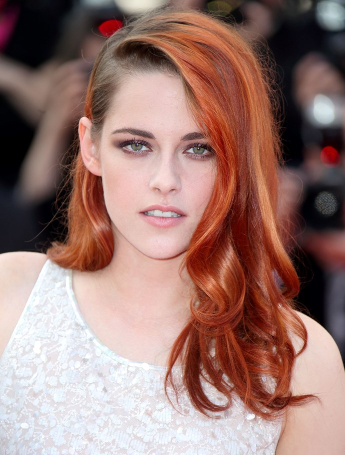 Pre-chop, Kristen shocked all of us with a new flaming orange shade, which she dyed for her upcoming movie *American Ultra*. The bright tone is bang on this season's rainbow hair trend, and also brings out her piercing green eyes.