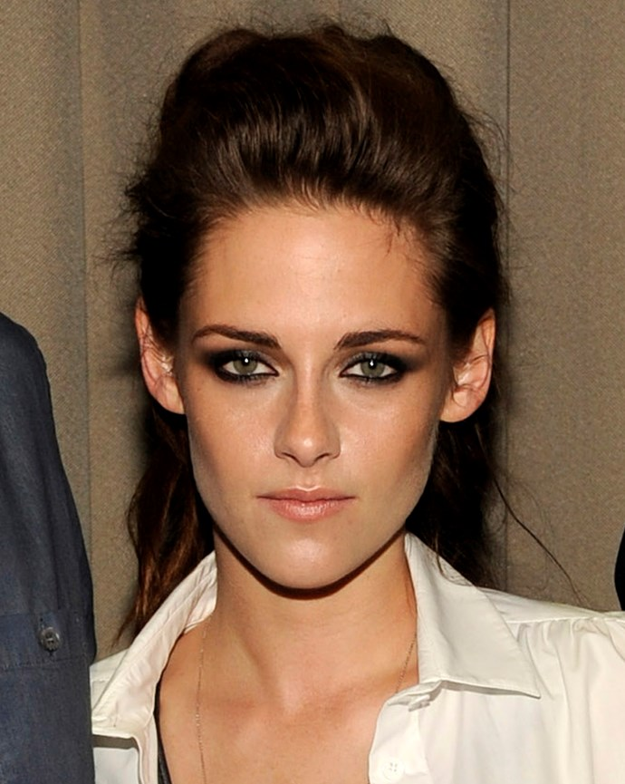 Making a big beauty statement with bronzed skin, sexed-up smoky eyes and dramatic hair volume.