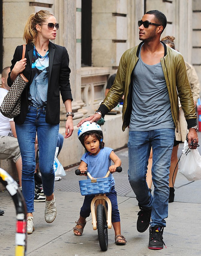Big brother Phyllon Joy is three years old, wears Birkenstocks, and rides a bike with a wooden basket. Heart – melted.