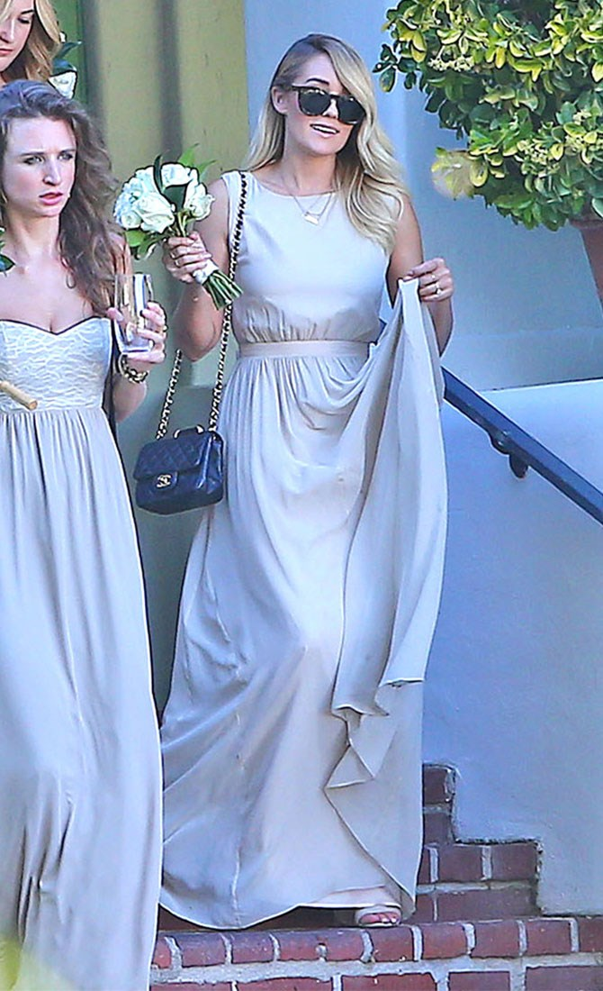 Lauren Conrad managed to put her own spin on her bridesmaid attire at Maura McManus and David Oehm's Californian wedding adding a Chanel bag and oversized sunnies – perfect for tomorrow's hangover. Take note, ladies.