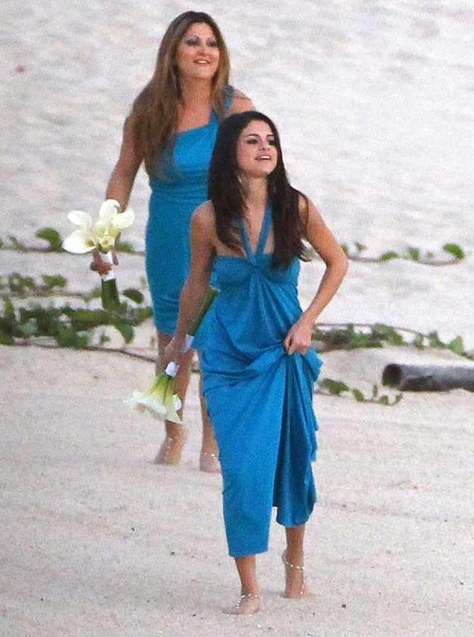 Selena Gomez couldn't escape the paps (or Bieber's arms), when she was called upon to be a bridesmaid at these Mexican beachside nuptials. The bridal party was observation the necessary 'something blue'.