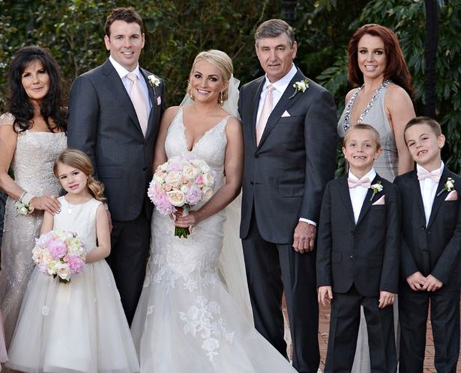 Britney Spears took out the top honour at little sis' Jamie Lynn's wedding as chief bridesmaid, looking smouldering in an embellished grey number, and her boys looked pretty cute in their suits too.