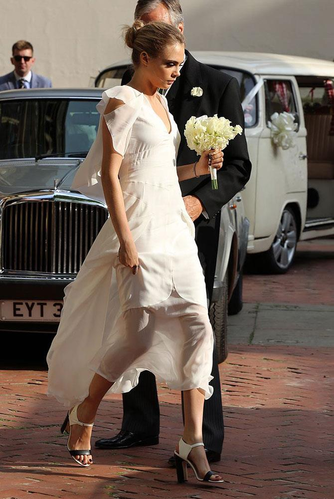 **Cara Delevingne** <br><br> When she isn't walking major fashion runways, Cara Delevingne is walking her sister down the aisle. In a white, flowing Chanel gown, Delevingne played one of 17 bridesmaids for big sister Poppy's wedding.