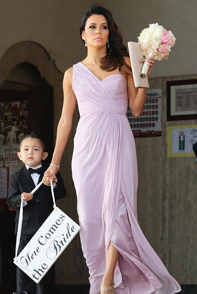**Eva Longoria** <br><br> This time around, *Desperate Housewives* star, Eva Longoria played bridesmaid, wearing in a pastel purple gown, for friend, Bonnie Rodezno. Even holding hands with the adorable ring bearer, to walk down the aisle.