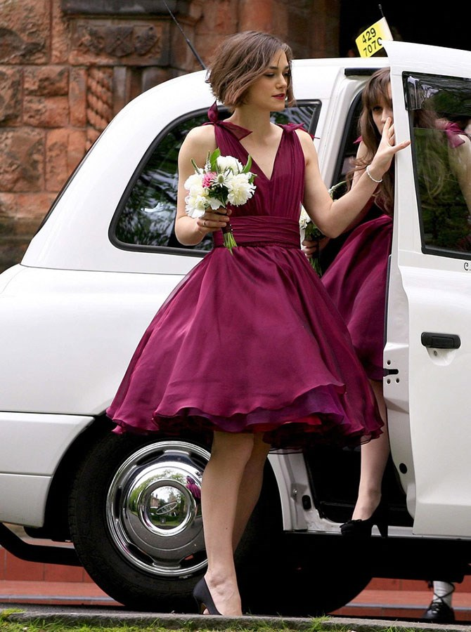 Keira Knightley proved she's a top sister when she fulfilled her bridesmaid duties for brother Caleb, in this swinging '50s, boysenberry frock just days before the royal wedding.
