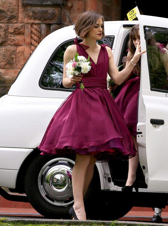 **Keira Knightley** <br><br> Keira Knightley may stay notoriously quiet, but she has proven to be an incredible sister when she fulfilled her bridesmaid duties for brother Caleb, in this swinging '50s, boysenberry frock.