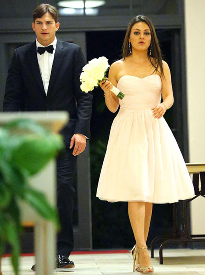 **Mila Kunis** <br><br> It looks like both Mila Kunis and Ashton Kutcher have walked down the aisle before, but not at their own wedding. Instead, Kutcher was Kunis' date for her brother Michael's wedding, in 2013.