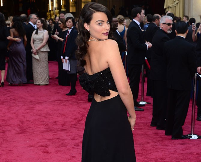 Margot's makeup is on double duty – a strong brow *and* deep merlot lip. Too much? Never. Just do it.