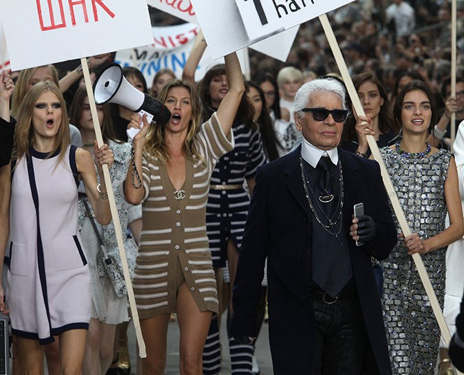 "The signs held messages like 'History is her story', 'Be your own stylist', 'Tweed is better than tweet' and 'Women's rights are more than alright'. The march also referenced Emma Watson's [HeForShe UN campaign](http://www.cosmopolitan.com.au/celebrity/celebrity-gossip/2014/9/celebs-support-emma-watsons-heforshe-campaign-/|target=""_blank"") with one male model strutting down the catwalk carrying a 'He For She' sign."