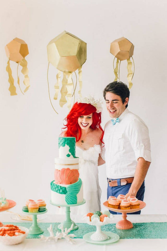 The decorations are pastel perfection. Not to mention that cake is everything we've wanted since we first saw *The Little Mermaid* on VHS.