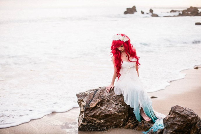 It wouldn't be a Little Mermaid themed wedding without Ariel washed up on a rock.