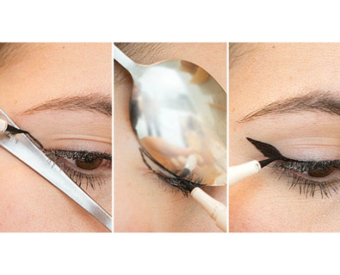 4. Use a spoon to create the perfect winged liner. Holding the stem of a spoon against the outer corner of your eye, draw the straight line as the first step for your cat-eye. Then, flip the spoon so it's hugging your eyelid, and use the rounded outer edge to create a perfectly curved winged effect.