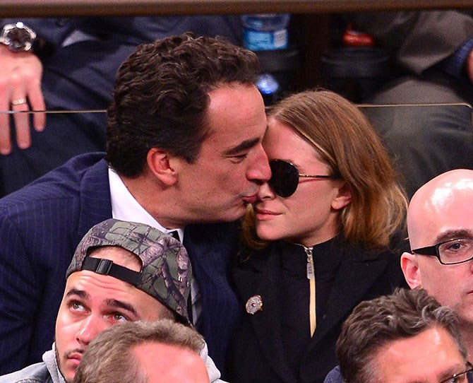 """Mary-Kate Olsen and her fiancé (or are they [already married](http://www.cosmopolitan.com.au/celebrity/celebrity-gossip/2014/10/mary-kate-olsen-olivier-sarkozy-married/
