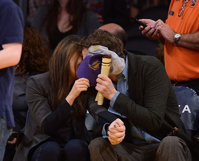 Ashton Kutcher and Mila Kunis tried to hide behind a cap. But we're all onto them.