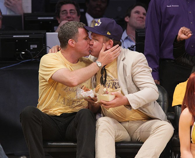 Will Ferrell and John C. Reilly stopped eating their burgers for a smooch. Because, STEP BROTHERS.