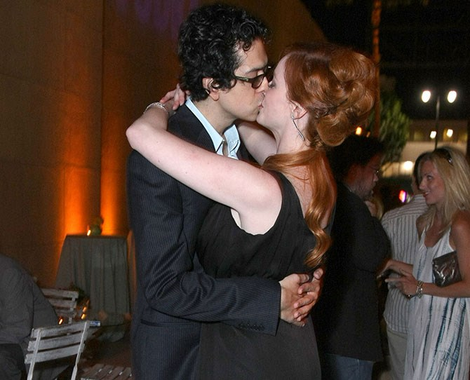 Christina Hendricks isn't afraid to show the world how in love she is with Geoffrey Arend. And we're thinking he doesn't mind showing off their romance either.